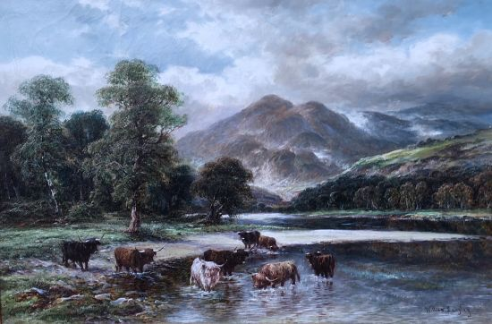 Highland cattle by a Scottish Loch
